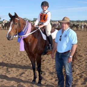Charlotte Bennetts from Cassilis Pony Club in Zone 7 is pictured with President of Pony Club NSW, Mr Wayne Pernice. Photo: Paul Smith Photography